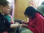 Muni drawing with henna